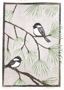 Chickadees in Pine Tree in Winter