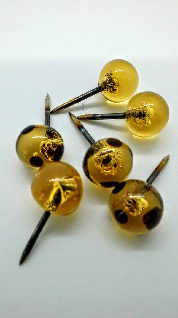 Amber with black dots glass push pins