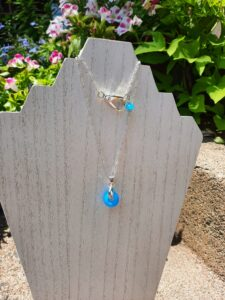 Brightest blue on a silver chain necklace