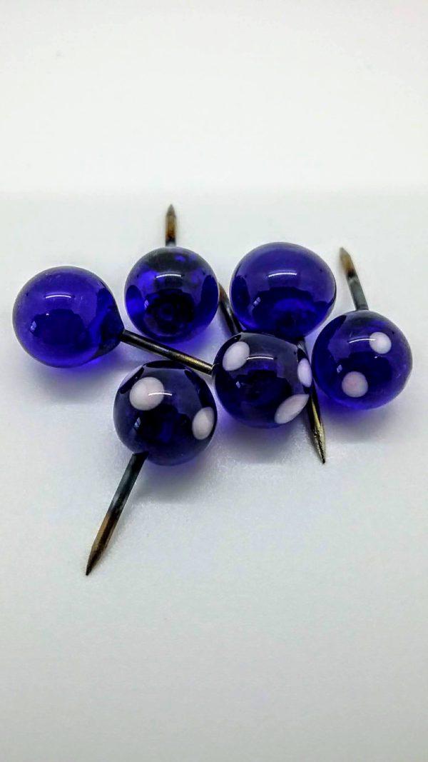 Cobalt blue glass with light pink dots push pins