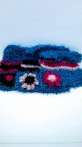 Set of 3 washable and reusable scrubby hand-crocheted dishcloths with extra scrubby middles and flowers details. Set of 3 coordinating lavender dishcloths with black, light and bright pinks stripes.