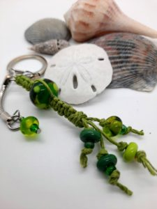 Forest and lime macramé zipper pull