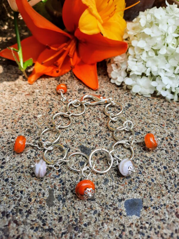 Gold swirl orange and pink dangles chain bracelet