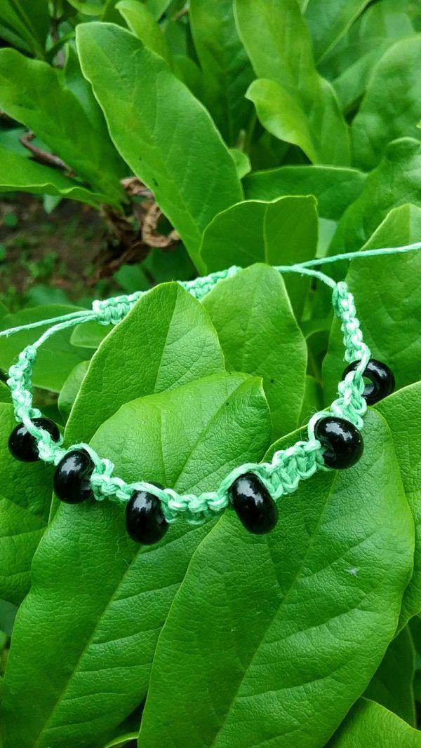 Grasshopper - black glass beads in mint green hemp