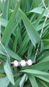 Light pink beads on silver necklace