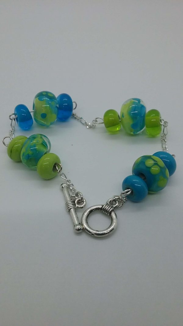 Lime and turquoise glass bead in silver chain bracelet