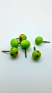 Lime with orange dots glass push pins
