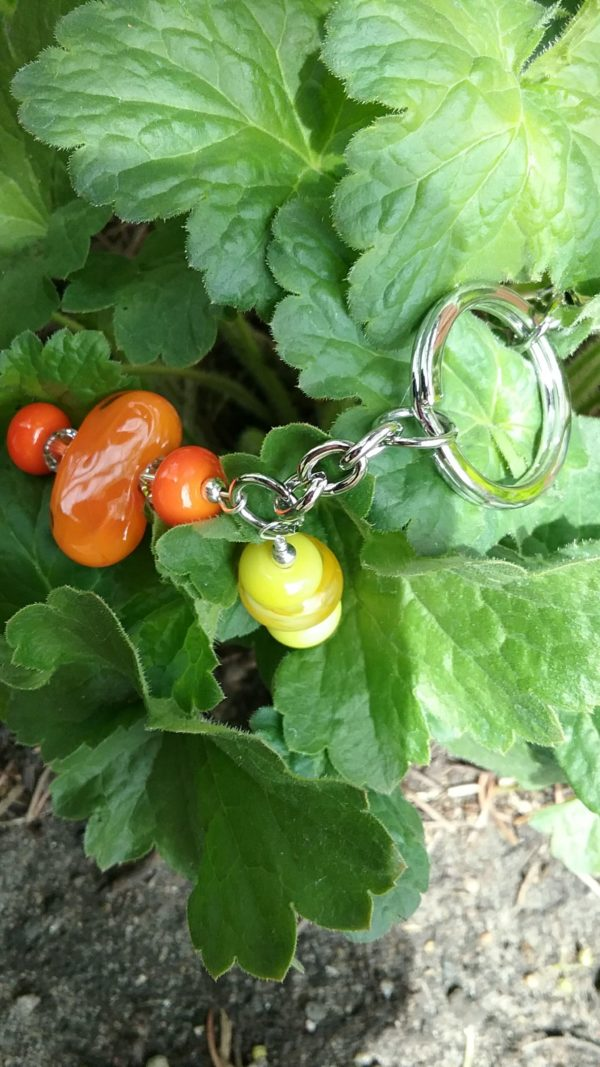 Orange and yellow glass beads on a silver key chain with purse clip
