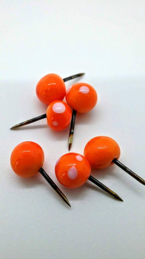 Orange with white dots glass push pins