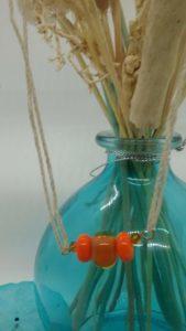 Orange glass beads on hemp necklace