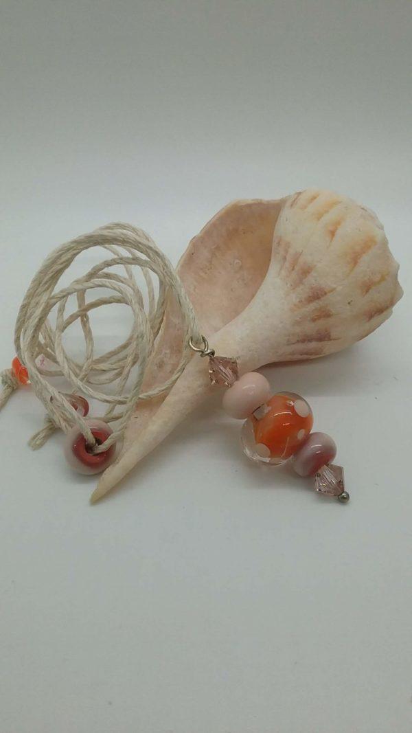 Orange Pink glass beads on hemp necklace