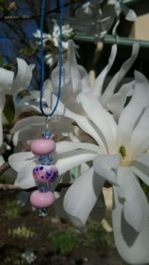 Pink and blue pendant on blue hemp necklace