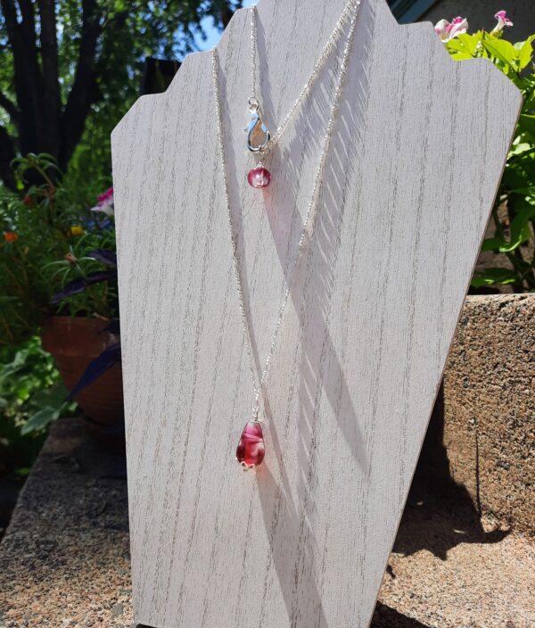 Raspberry swirl teardrop on a long silver chain necklace