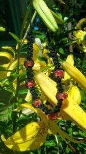 Red Dragon - red swirled glass beads in black hemp