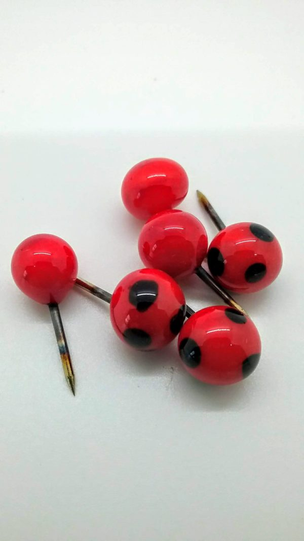 Red with darkest blue dots glass push pins