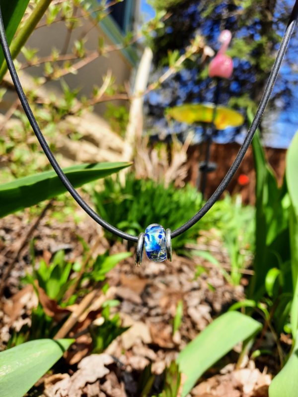 Floating clear blue swirl silver rings necklace