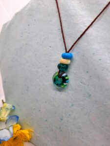 Teal with ivory and turquoise stripes and ivory spacer tactile - necklace