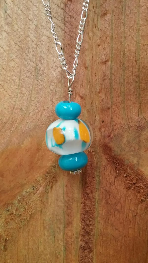 Turquoise white with yellow pendant on silver chain necklace