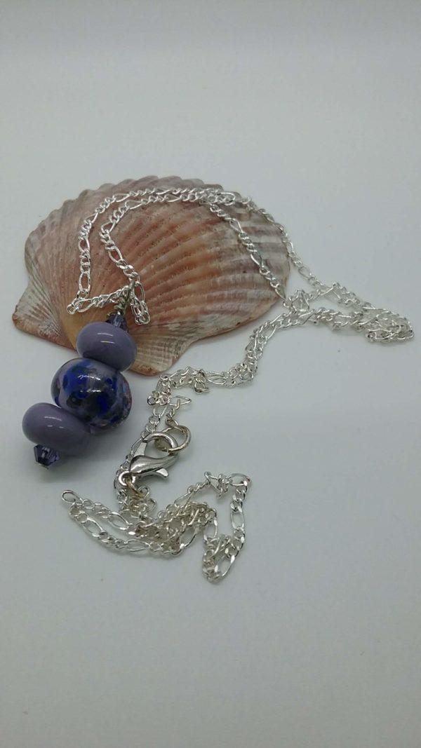 Violet blue pendant on silver necklace