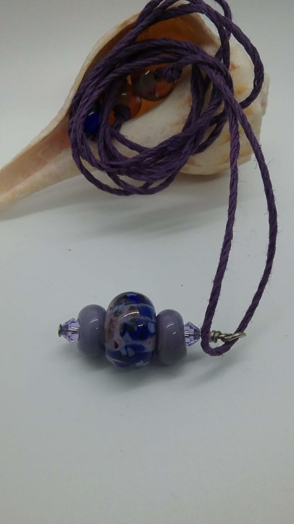 Violet and Blue glass bead pendant on hemp