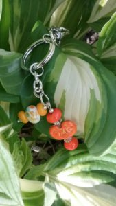 Orange, yellow and white glass beads on a silver keychain purse clip