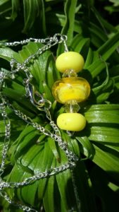 Yellow glass beads on a silver chain necklace
