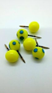 Yellow with turquoise dots glass push pins